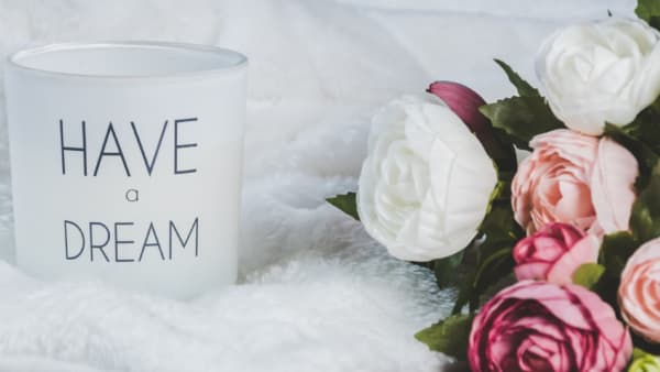 Flowers and cup with Have a Dream slogan